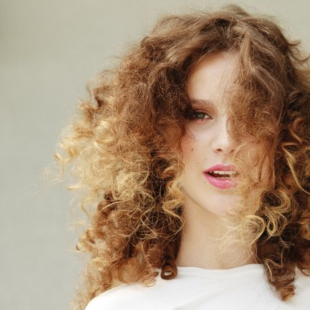 Photo for Portrait of a young beautiful girl with magnificent curly hair - Royalty Free Image
