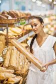 Woman choose Fresh baked bread