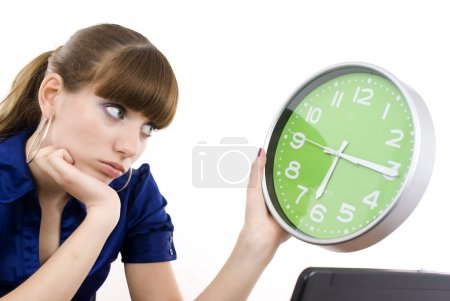 Photo for The business woman with clock in hands. It is isolated on a white background - Royalty Free Image