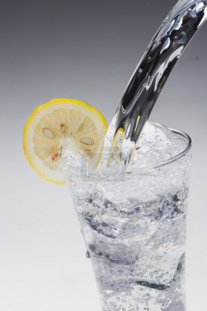 Photo for Pouring water into glass - Royalty Free Image