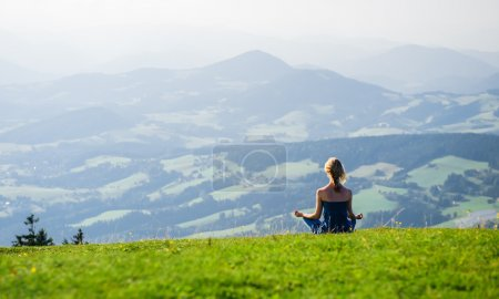 Young woman meditating outdoors