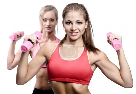 Two attractive athletic girl with dumbbells