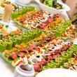 Trays with various delicious appetizer...