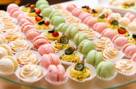 Photo for Tray with delicious cakes and macaroon - Royalty Free Image