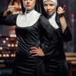 Attractive young nuns posing in the church...