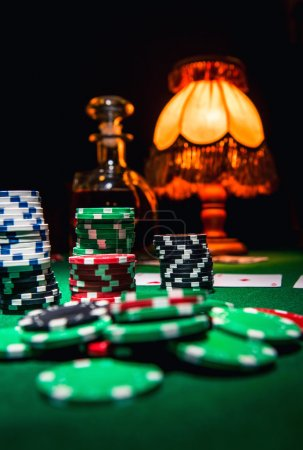 Gamble background, poker chips, cards and bottle of cognac