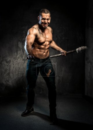 Photo for Muscular man holding torch - Royalty Free Image