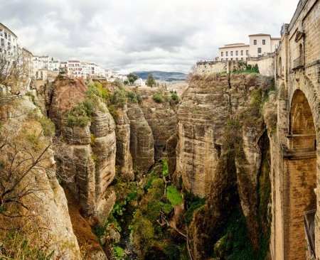 Photo for Amazing view of the Ronda canyon and the famous white village. Province of Malaga, Andalusia, Spai - Royalty Free Image