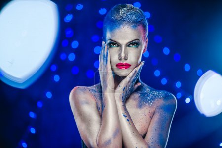 Photo for Beautiful woman with creative bright make-up over glowing lights background - Royalty Free Image