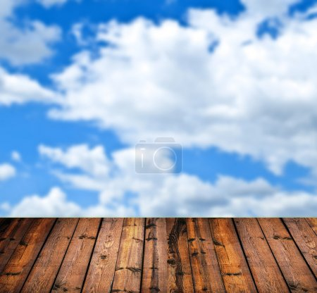 Wood floor and blue sky