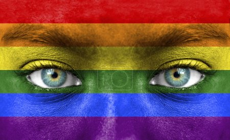Human face painted with flag of Pride (Gay)