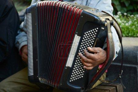 Man at street playing accordion