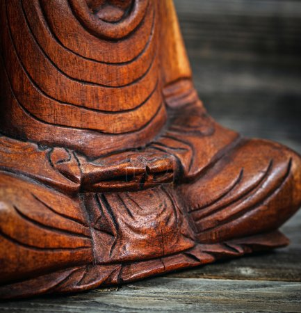 Meditation conceptual image with focus on Buddhas hands