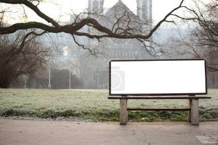 Blank billboard on bench at city park