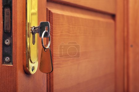 Photo for Key in keyhole with blank label - Royalty Free Image
