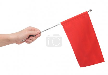 Hand holding a red flag isolated on white background. Put your o