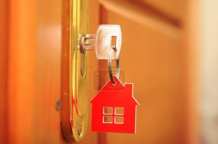 Photo for A key in a lock with house icon on it - Royalty Free Image