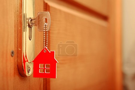 Photo for Symbol of the house and stick the key in the keyhole - Royalty Free Image