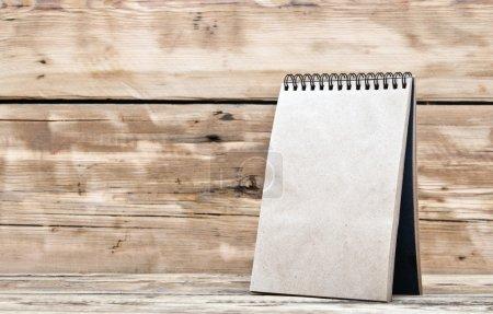 blank desk calendar on old wooden table
