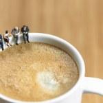 Miniature business team having a coffee break...