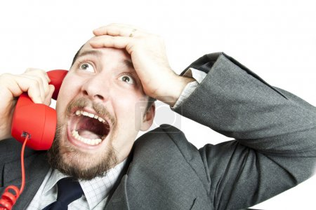 Photo for Businessman screaming into a phone - Royalty Free Image