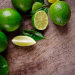 Fresh limes on wooden background...