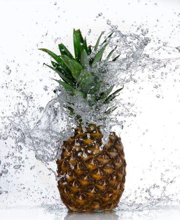 Pineapple with water splash