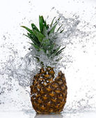 Pineapple with water splash