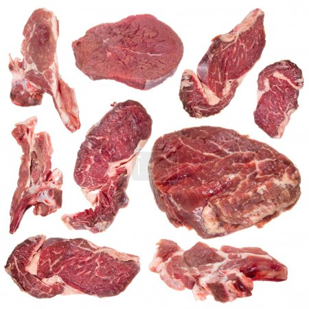 Photo for Collection of raw beef steaks and lamb chops over white - Royalty Free Image