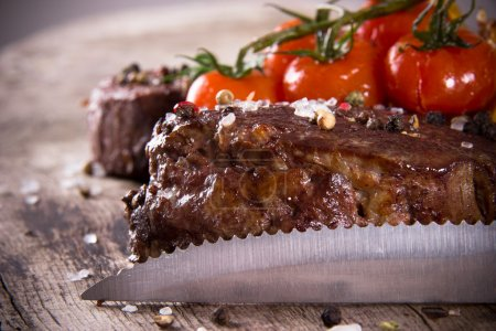 Delicious beef steaks with knife