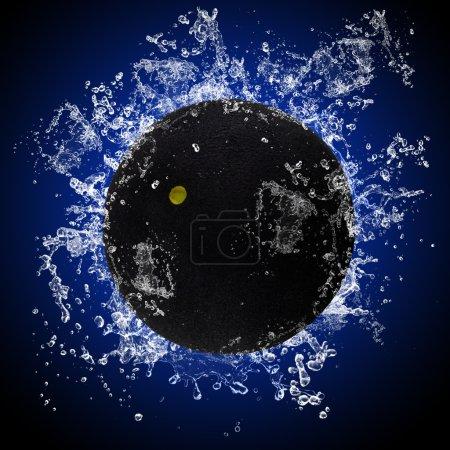 Squash ball in splashing water