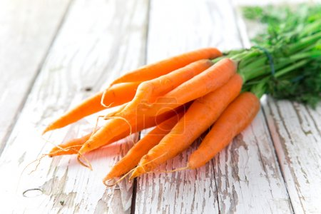 Photo for Fresh carrots on wooden background - Royalty Free Image