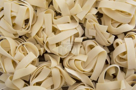 Spilled raw pappardelle pasta