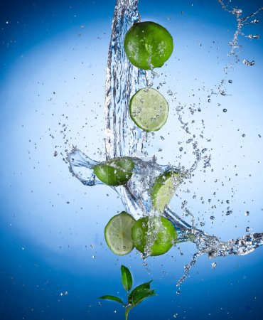 Photo for Limes with water splash isolated on white - Royalty Free Image
