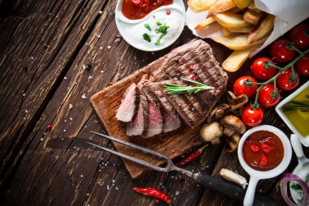 Photo for Tasty beef steak with vegetable side-dish, close-up. - Royalty Free Image
