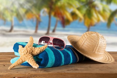 Photo for Summer accessories on sandy beach, close-up. - Royalty Free Image