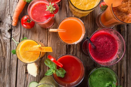 Photo for Fresh juice mix fruit, healthy drinks on wooden table. - Royalty Free Image