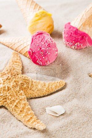Tasty ice creams on sandy beach