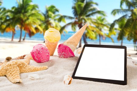 Sunny beach with ice creams and tablet