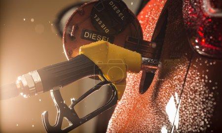 Gasoline dispenser in the car.