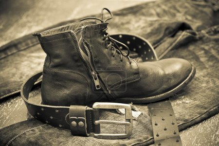 Fashionable leather shoes, leather belt and jeans. cowboy style