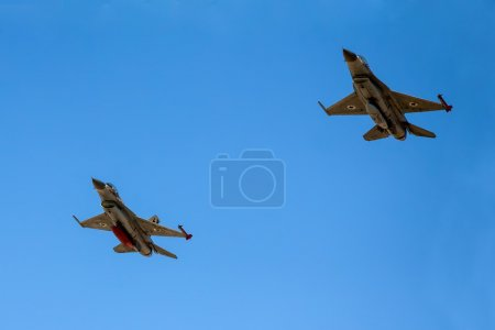 Fighter jet F-16 flying with a blue sky background...
