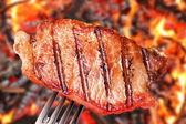 Steak on a fork.