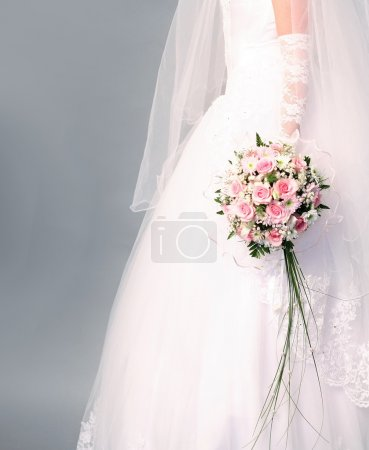 Wedding. Bouquet of roses in bride