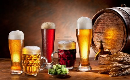 Photo for Beer barrel and draft beer by the glass. Dark background. - Royalty Free Image