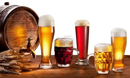 Photo for Beer barrel with beer glasses on a wooden table. Isolated on a white background. This file contains clipping path. - Royalty Free Image