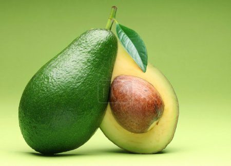 Avocado isolated on a green.