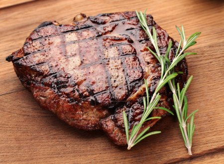 Photo for Beef steak on a wooden table. - Royalty Free Image