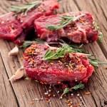Raw beef steak on a dark wooden table....
