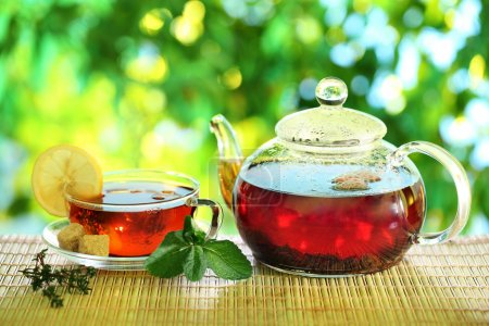 Cup of tea and teapot on a blurred background of n...